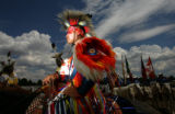 Lamar Spoonhunter, 25, CQ, from the Windriver reservation in Wyoming, waits for the Grand Entry...