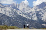 With Mt. Whitney ahead, Carter Hawke, 17, left, walks with his father Ferg Hawke, right, as Ferg...