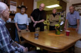 (BRUSH, Colo., March 29, 2004) Harold Gray, left in plaid shirt, sings a new composition as a...