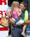 Grand Junction Fire Captain John Hall comforts a Girl who was one of 7 Children & 2 Infants in...