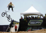 Damian Conolly (cq), 20, of Sydney, Australia jumps off his bike midair during the BMX Dirt Open...