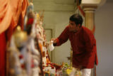 DLM392 Ravi Krishnaswamy, 29, of Centennial prepares for the evening services at the Hindu Temple...