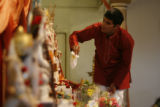DLM394  Ravi Krishnaswamy, 29, of Centennial prepares for the evening services at the Hindu Temple...