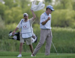 Caddie Jim Brewer (cq), left, of Denver, cheers on Matt Zions of Kempsey, Australia as Zions...