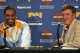 Carmelo Anthony, left, is all smiles as he sits next to Denver Nugget's owner Stan Kroenke, right,...
