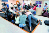 Reports gather around Amie Sperry, cq, left, daughter of murder victim Rocio Sperry, and her...