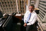 KAS017 Douglas Jones in his office at Jones Realty Group on Monday, July 10, 2006. (KEITH...