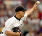 (DENVER, COLO., JUNE 15, 2004)  Colorado Rockies' pitcher #37, Joe Kennedy throws towards...