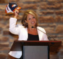DLM1277  Katie Couric holds up a Broncos hat as she proclaims her love of the team during a...