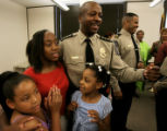 Gary Wilson(cq), center, stands with his daughters Naomi Wilson, 12, in red, and Courtney Wilson,...