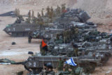 JRL867 - Israeli troops gather as they prepare to cross the border into southern Lebanon in...