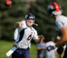 Broncos rookie quarterback Jay Cutler (#6) throws a pass to rookie tight end Tony Scheffler (#88)...