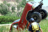 Palisade Colorado Fire Chief Richard Rupp Inspects a Dodge Truck that crashed into a canal...