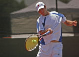 KAS677 Jeremy Wurtzman returns the ball during his match against Bart Scott during the men's...