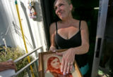 Rita Morgan (cq), 51,  one of Robert Browne's former wive holds a photo of herself when she was...