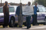 (DENVER, CO , June 29, 2004)  Freedom cab drivers held a protest outside the Freedom Cab offices...