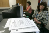 (L-R) ( Roni White (cq) and Joan Becchi (cq) Department of revenue employees, wait for applicants...