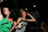 Shandi Mikes (cq), 16, Renee Pollack (cq), dance at a benefit for Molly Bloom, the East High...