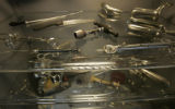Ryan Kramer, MD, (cq) Family Physician hac an antique medical tools collection in a display case...