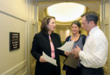 Rep. Diana DeGette, D-Colo., speaks with Communications Director Brandon MacGillis, right, and...