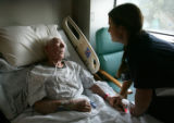 Nursing student Alexa Pighini (cq), 28, right, talks with patient Nolan Sandage (cq), after taking...