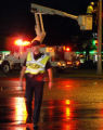 On rain soaked streets of Grand Junction Police Officer Cody Kennedy directs traffic at first st....
