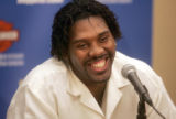Newly re-signed F/C Nene, left, is all smiles during a Thursday afternoon July 20, 2006 press...