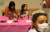 Ashley Wilson, 8, of Steamboat, far right, sports a tiara after getting her nails done during the...