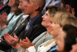 First Lady Laura Bush, center, applauds a speaker as she attends the Helping America's Youth...