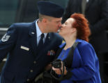 Tech. Sgt. Brian Webster kisses his wife Theresa after receiving the President's Volunteer Service...
