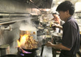 Dan Tang (cq), owner of Heaven Dragon Restaurant in Thornton prepares a meal for President George...