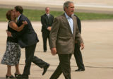 President George Bush makes his way to greet Tech. Sgt. Brian Webster  as  Rick O'Donnell gets a...