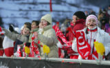 A group of Polish ski jumping fans sing and dance at the NH Individual Ski Jumping qualification...