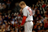 (DENVER, COLO., JUNE 16, 2004)  Boston Red Sox's pitcher #38, Curt Schilling kisses a crucifex...