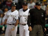 (DENVER, COLO., JUNE 16, 2004)  Colorado Rockies' #17, Todd Helton, left, argues with homeplate...