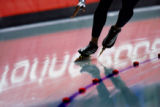 American speed skater Shani Davis races around a corner in the Men's 5000 Meter Long Track Speed...
