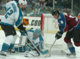 (DENVER, COLO.,  April 26, 2004)  Colorado Avalanche Matthew Barnaby, right, looks for the puck as...