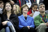 First Lady Laura Bush (center) took in the Men's 5000 Meter Long Track Speed Skating event at the...