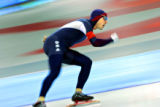 American speed skater Chad Hedrick races around the track during the Men's 5000 Meter Long Track...