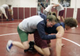 (left) Brooke Sauer (cq) 18, a senior at Golden high School wrestles Ryan Sprackling,(cq) 17 a Sr....