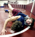 (top) Brooke Sauer (cq) 18, a senior at Golden high School wrestles Ryan Sprackling,(cq) 17 a Sr....