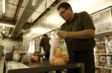 BOULDER., Colo., Feb. 28, 2006) Fulfillment Manager for Aspen Grove Market pulls a grocery order...