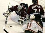 Avs gtoalie David Aebischer gets one of 29 of his game saves In the first period as the Colorado...
