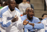 Newly acquired Denver Nugget players Reggie Evans, left, and Ruben Patterson,right, cheer on their...