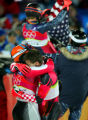 Men's Combined bronze medalist Rainer Schoenfelder (foreground left) hugs silver medalist Ivica...