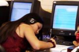 (DENVER., Colo., Feb. 14, 2006) Tenth grader, Marisa Trujillo (cq) takes notes as she work on the...