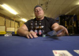 David Quick of Thornton tosses in his cards signaling him out of a round of Texas Hold 'Em at Mi...
