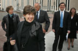 JPM380  Merilyn Cook smiles as she leaves federal court in Denver after she and six other named...