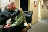 Whirled Peas catering company employee Derian Mericle, cq, left, comforts Stephen Tanner, cq, in...