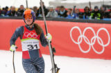 Lindsey Kildow looks up at her time at the finish of the women's downhill at San Sicario Fraiteve,...